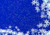 Vánoční modré pozadí ze sněhu — Stock fotografie