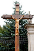 The crucifixion from a tree with Jesus's gilt figure — Stock Photo