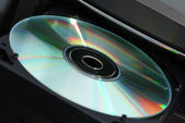 Disk in the drive — Stock Photo