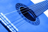 Guitar background blue — Stock Photo