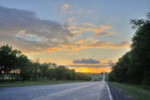 Road and sunset — Stockfoto