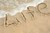 "Inscription ""life"" on sand — Stock Photo"