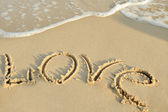 "Inscription ""love"" on sand — Stock Photo"