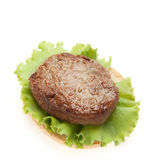 Cutlets with a leaf of salad on on bread — Stock Photo