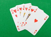 Playing cards on a green background — Stock Photo