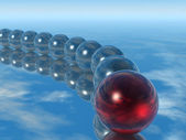 Row spheres with leader red color — Stock Photo
