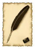 Feather quill and inkwell on an old paper — Stock Photo