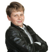 Portrait of the teenager in a leather jacket — Stock Photo
