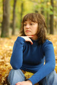 The girl reflecting in an autumn wood — Stock Photo