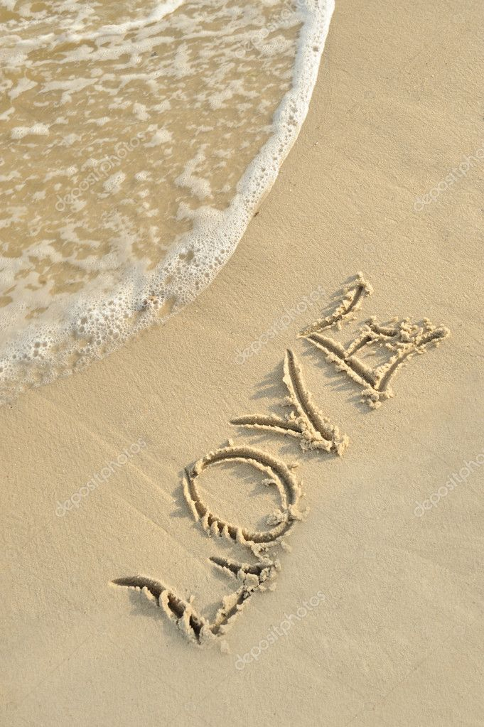 Inscription love on sand. Sea coast with a rolling wave on an inscription — Stock Photo #6194855