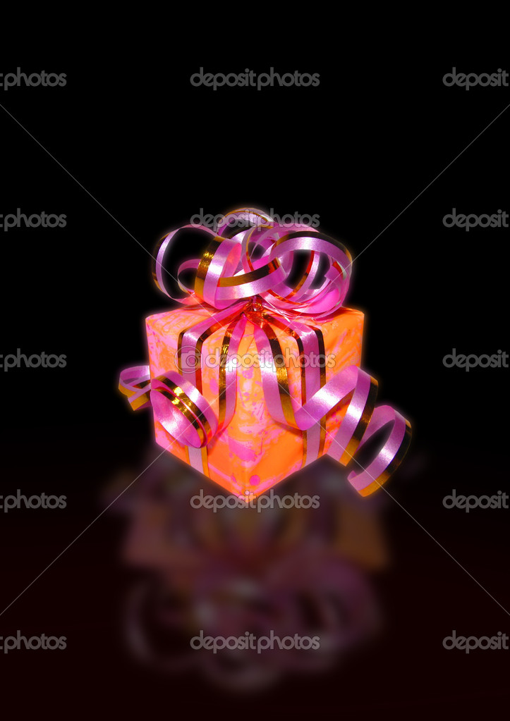 Gift of boxes tied up by a tape (with effect of a luminescence and reflection on the black varnished surface) — Stock Photo #6196523