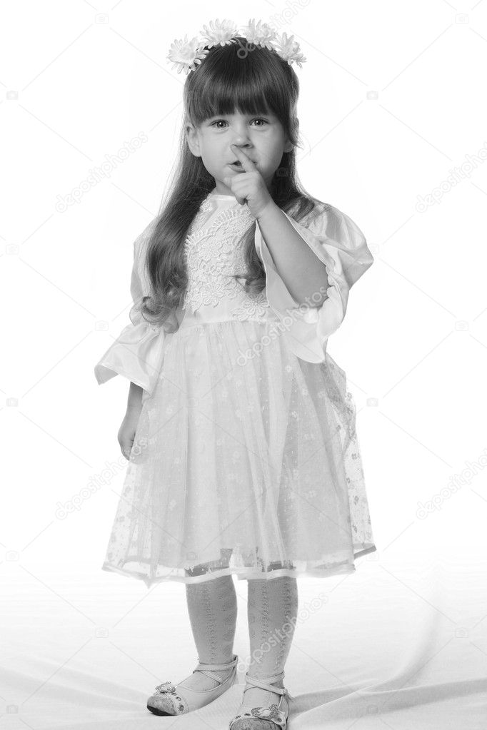 The girl in a white dress. It is isolated on a white background. Age 3 years  Stock Photo #6198324