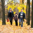 Family in autumn forest — Stock Photo #6540739