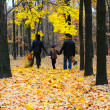 Family in autumn forest - Stock Photo