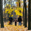 Stock Photo: Family in autumn forest