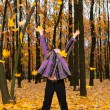 The girl with the lifted hands autumn forest - Foto Stock