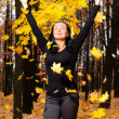 The women with the lifted hands autumn forest - Stock Photo