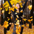 The women with the lifted hands autumn forest — Stock Photo