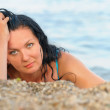 The attractive woman on seacoast — Stock Photo