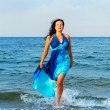 The attractive woman exit the sea — Stock Photo