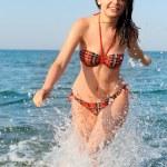 The joyful woman runs on sea water — Stock Photo #6541007