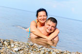 Happy young couple in the sea — Stock Photo