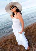 Portrait of the young woman in a hat. Seacoast — Stock Photo
