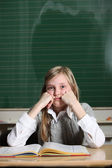 Child in the school thinks — Stock Photo