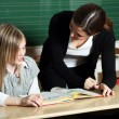 -Basic student in primary school shows. — Stock Photo