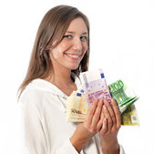 Happy young woman with thousands of euros in the hand — Stock Photo