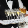 Waiters served champagne and wine — Stock Photo