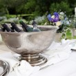 Many bottles of champagne in a champagne cooler — Stock Photo