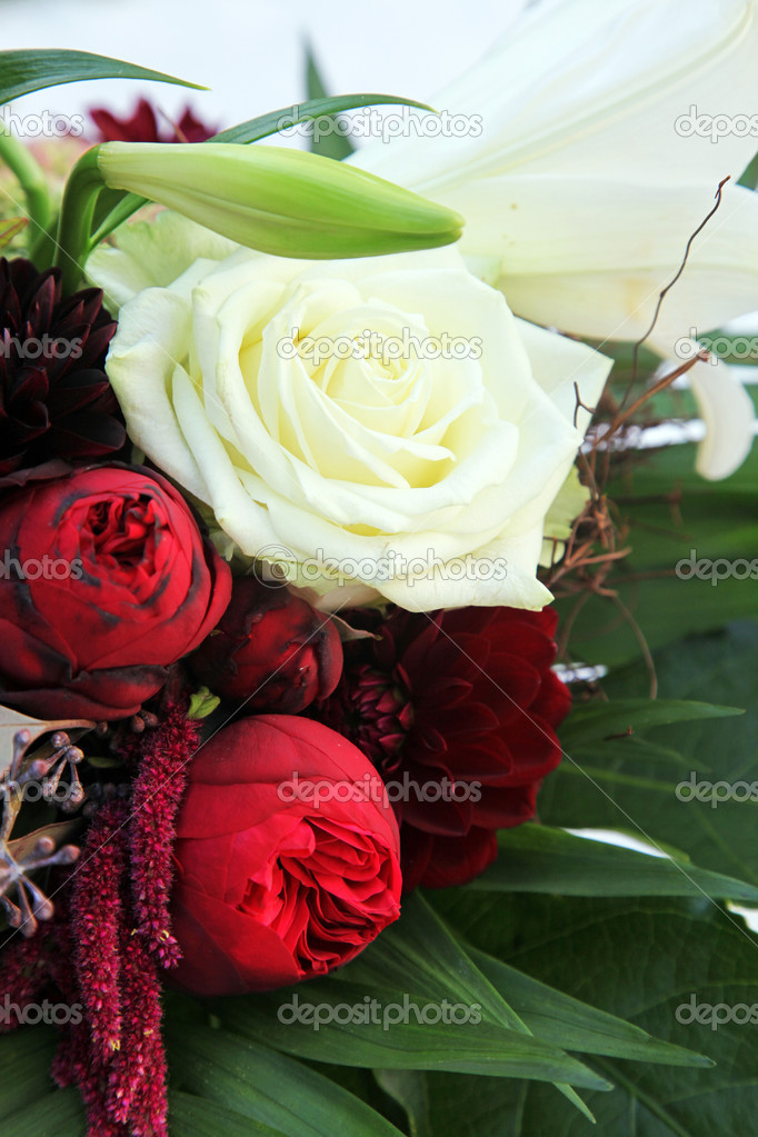 Close-up of white roses and lilies - vertically, with space for text  Stock Photo #6726878