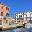 Small bridge over canal and old houses in Venice. — Stock Photo