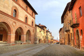 Paved street among historic houses in Saluzzo, Italy. — Stock Photo