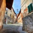 Narrow paved street among houses in Saluzzo, Iyaly. — Stock Photo #6255983