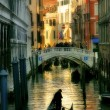 Gondola silhouette on venetian canal. — Stock Photo