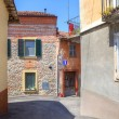 Old house among new in Diano D'Alba, Italy. — Stock Photo
