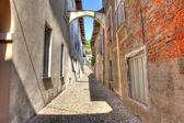 Old narrow street amont ancient houses in Avigliana, Italy. — Stock Photo