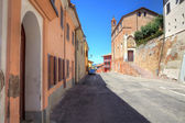 Houses and old church in Roddi, Italy. — Stock Photo