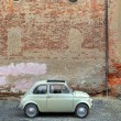Retro car in front of ancient wall. — Stock Photo