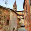 Stock Photo: Narrow paved street among houses in Saluzzo, Iyaly.