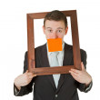 Businessman with wooden frame — Stock Photo #5381087