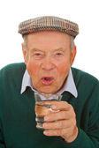 Male senior drinking water — Stock Photo