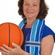 Middle aged woman with basketball — Stock Photo