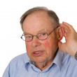 Male senior with hand on ear — Stock Photo