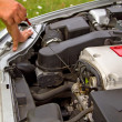 Stock Photo: Checking engine oil