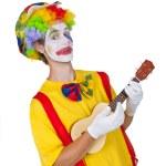 Colorful clown with ukulele — Stock Photo