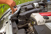 Checking engine oil — Stock Photo