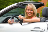Young woman happy about her new drivers license — Stock Photo